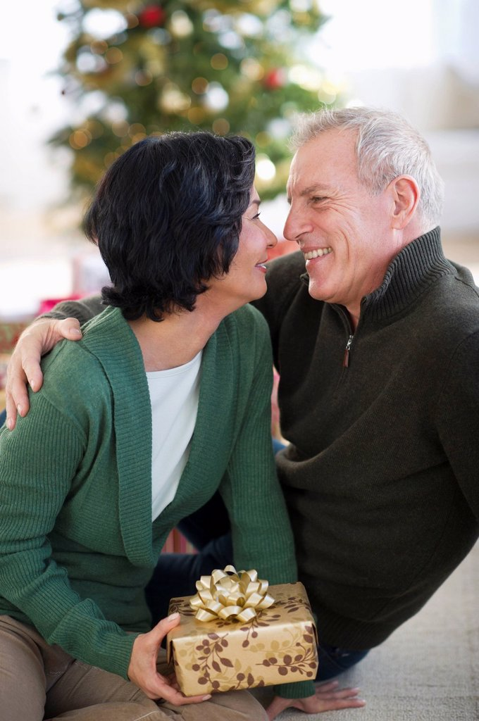 Happy mature couple on christmas time : Stock Photo