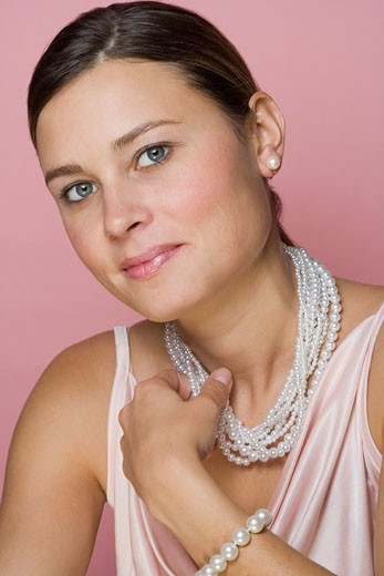Studio shot of woman wearing pearls : Stock Photo