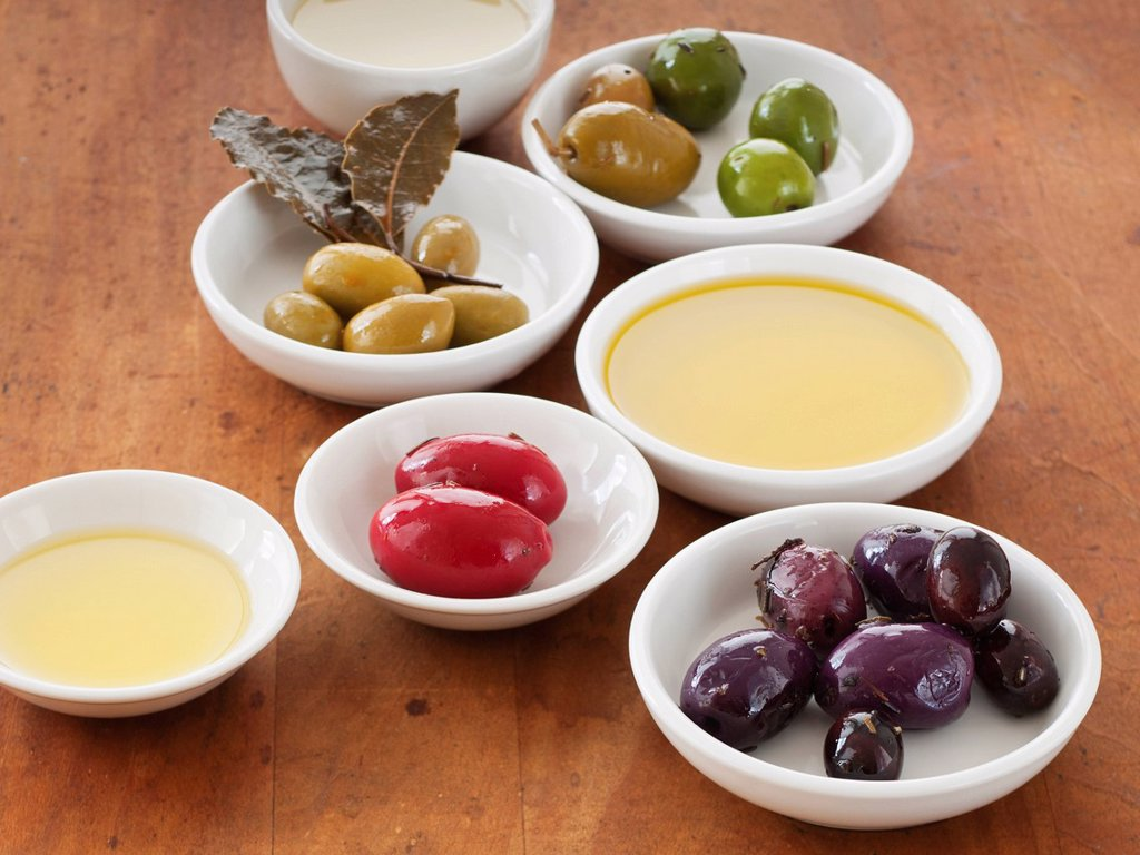 Close up of bowls with olives and sauces : Stock Photo