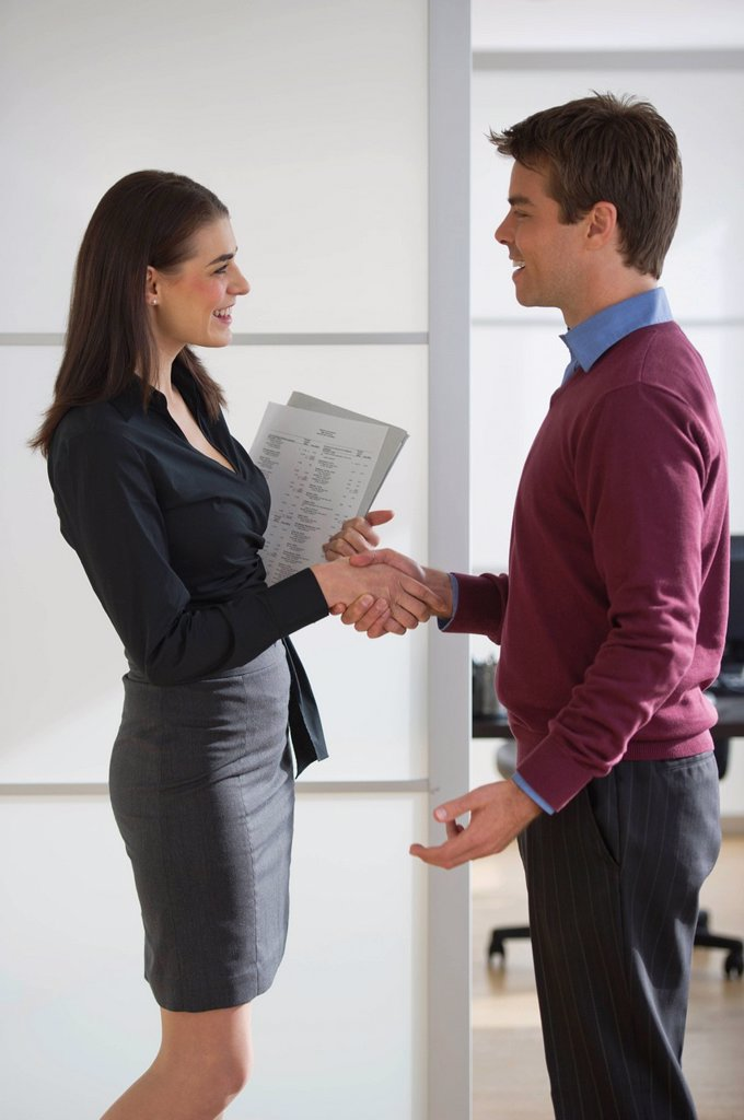 Stock Photo: 1795R-43847 Pair of businesspeople shaking hands in office