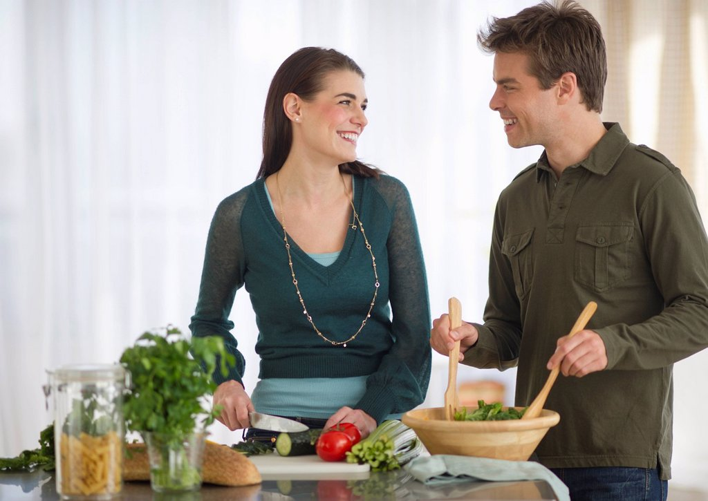 Couple cooking in kitchen : Stock Photo