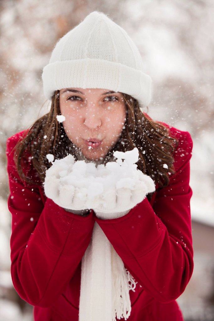 USA, Utah, Lehi, Portrait of young woman blowing snow : Stock Photo