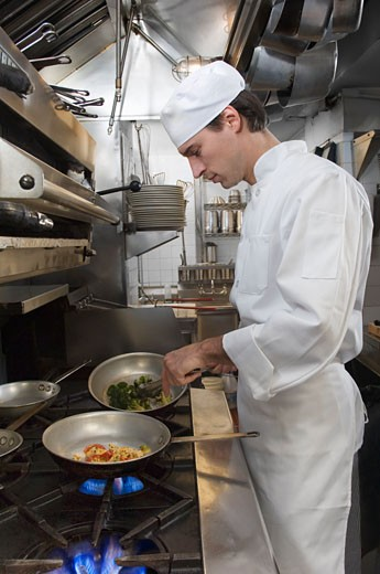 Stock Photo: 1795R-4607 Male chef in restaurant kitchen