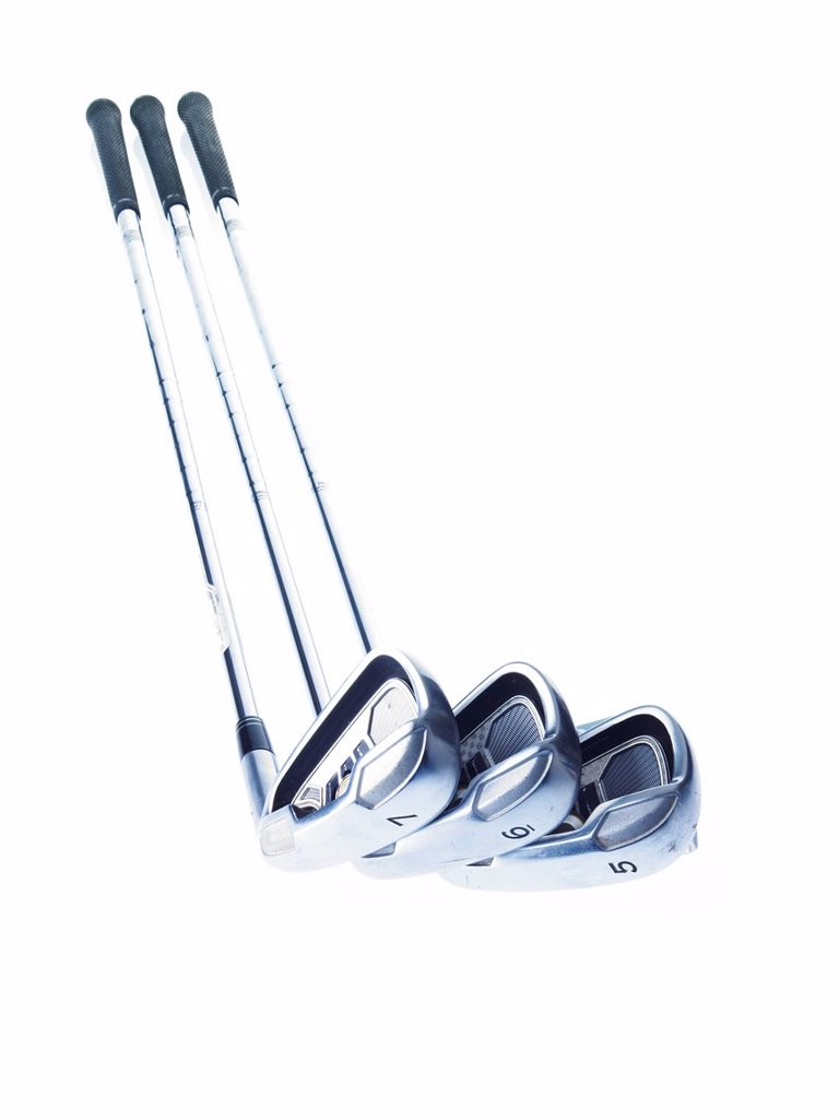 Three golf clubs on white background : Stock Photo