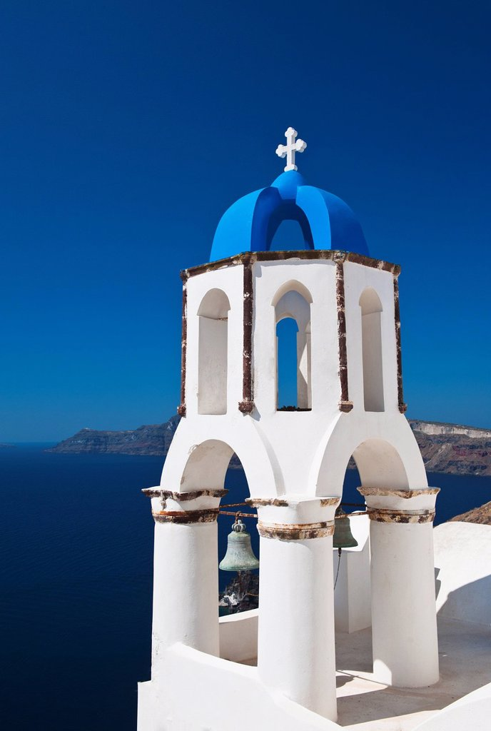 Greece, Cyclades Islands, Santorini, Oia, Church bell tower at coast : Stock Photo