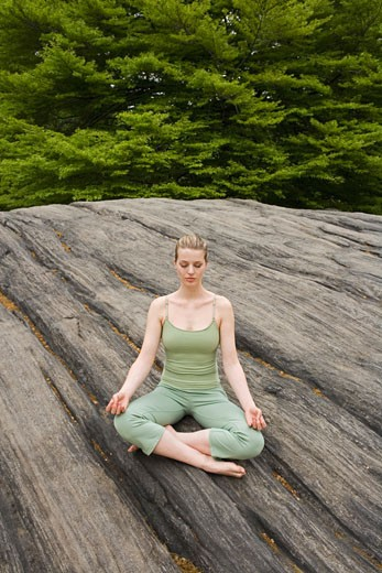 Woman practicing yoga in park : Stock Photo