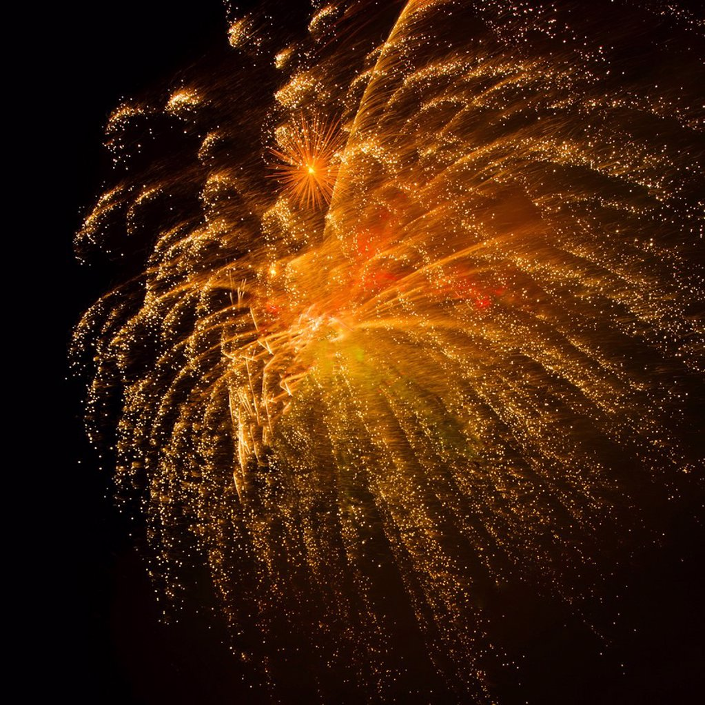 Fireworks explosion against night sky : Stock Photo