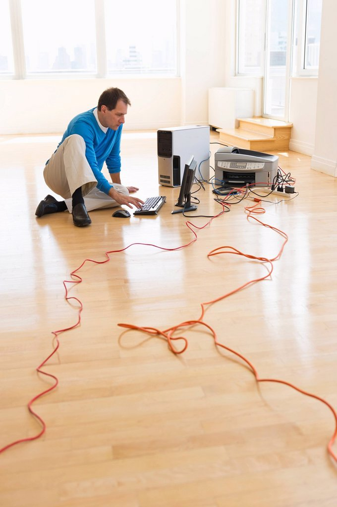 Businessman setting up internet in new office : Stock Photo