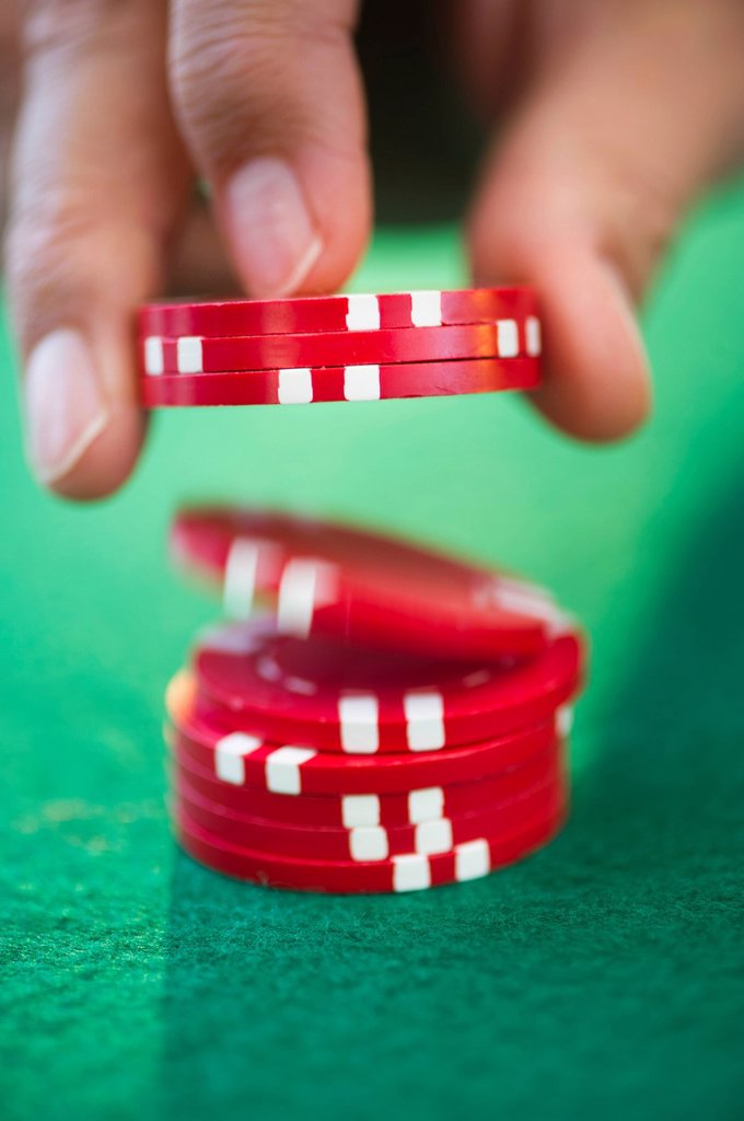 Stock Photo: 1795R-48439 Hand handling gambling chips