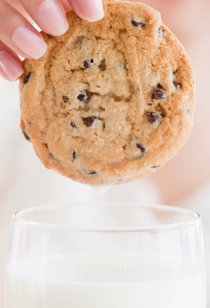 Close up of woman´s hand holding cookie : Stock Photo