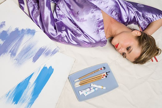Woman in purple kimono with paint and brushes : Stock Photo