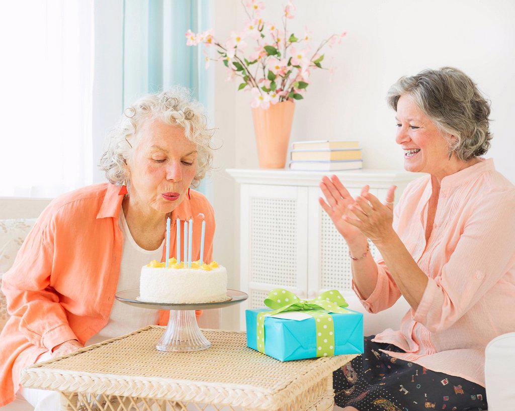 Two senior women celebrating birthday : Stock Photo