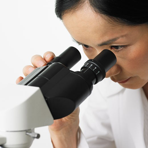 Stock Photo: 1795R-5023 Close up of woman looking in microscope