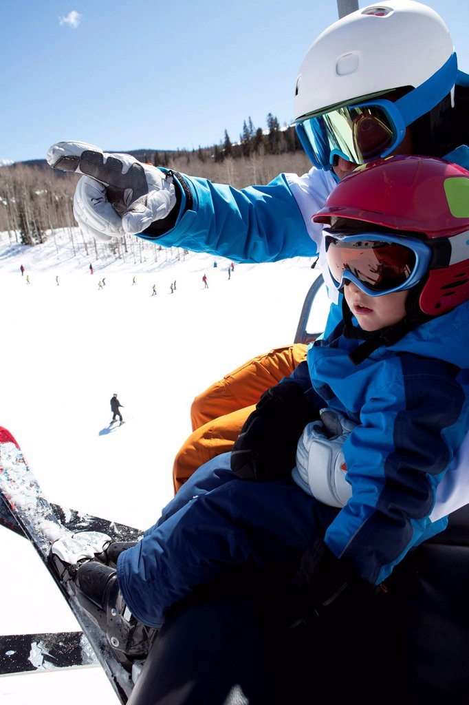 USA, Colorado, Telluride, Father with son 2_3 on ski lift : Stock Photo