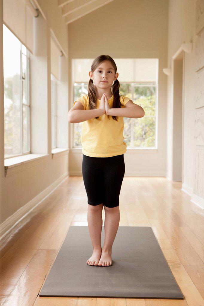 Stock Photo: 1795R-50780 Girl 6_7 practicing yoga