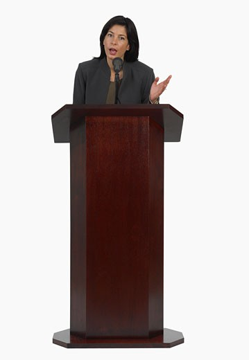 Stock Photo: 1795R-5103 Businesswoman speaking at podium