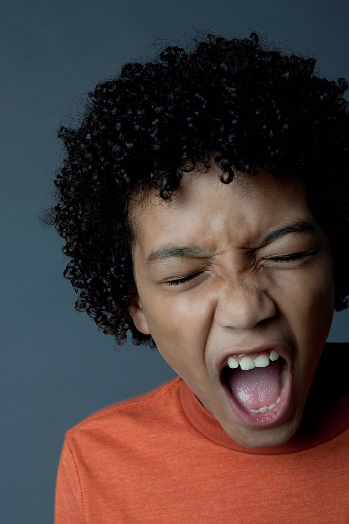 Stock Photo: 1795R-56481 Studio portrait of boy 8_9 screaming