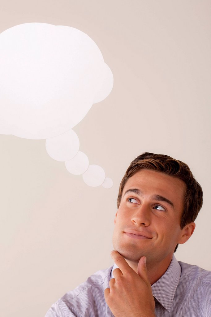 Stock Photo: 1795R-56606 Studio portrait of businessman with thought bubble