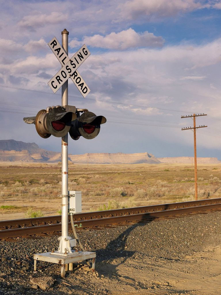 Stock Photo: 1795R-56888 USA, Utah, Desert landscape with railroad crossing