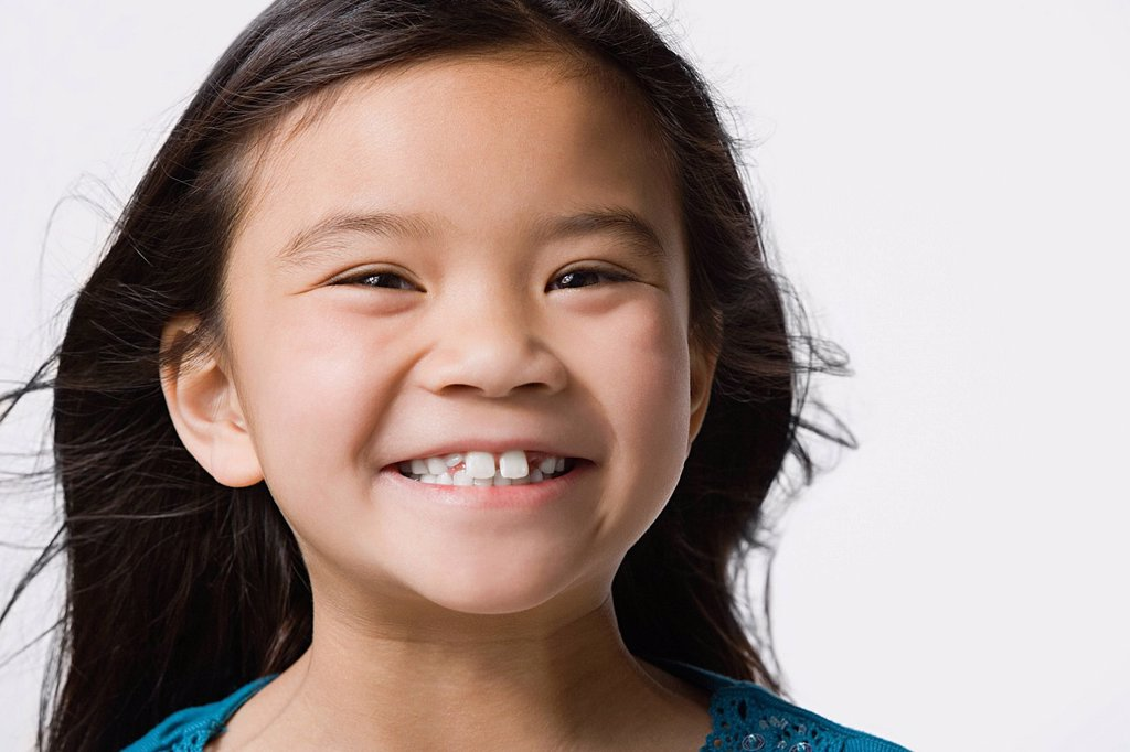 Stock Photo: 1795R-57649 Portrait of smiling girl 8_9, studio shot