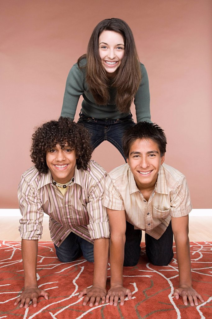 Stock Photo: 1795R-58165 Portrait of teenage boys and girl 14_15, 16_17