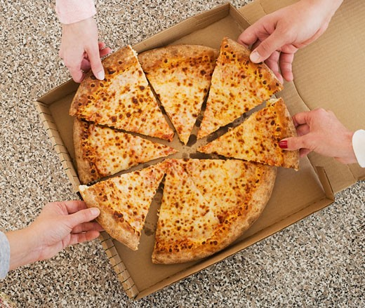 People talking slices of pizza from box : Stock Photo