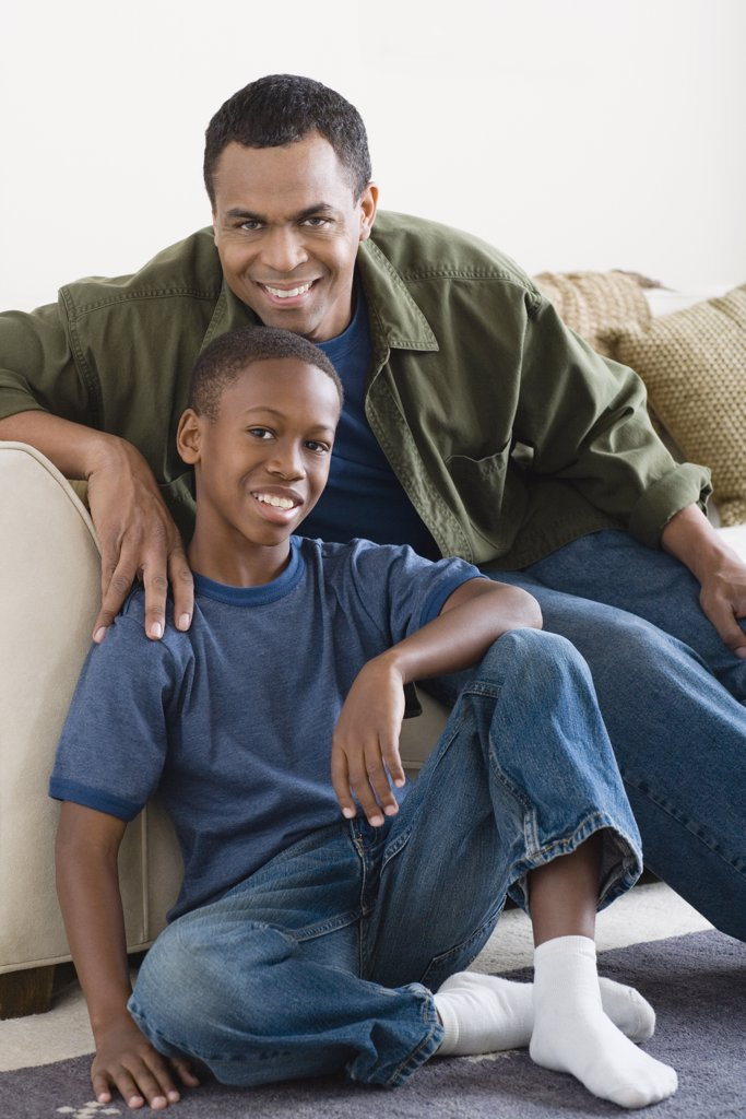 Stock Photo: 1795R-60261 Portrait of Father and Son (12-13) at home