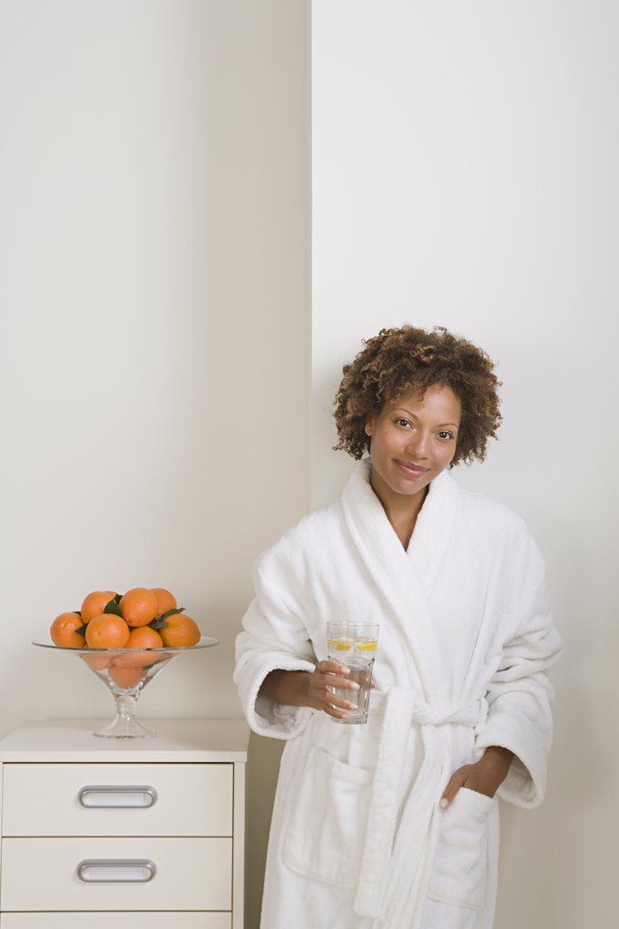 Stock Photo: 1795R-60955 Attractive woman drinking fresh orange juice