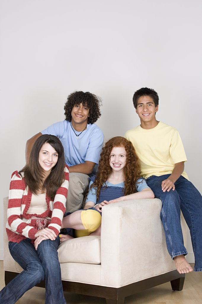Stock Photo: 1795R-61091 Portrait of teenagers (14-15,16-17) sitting on armchair