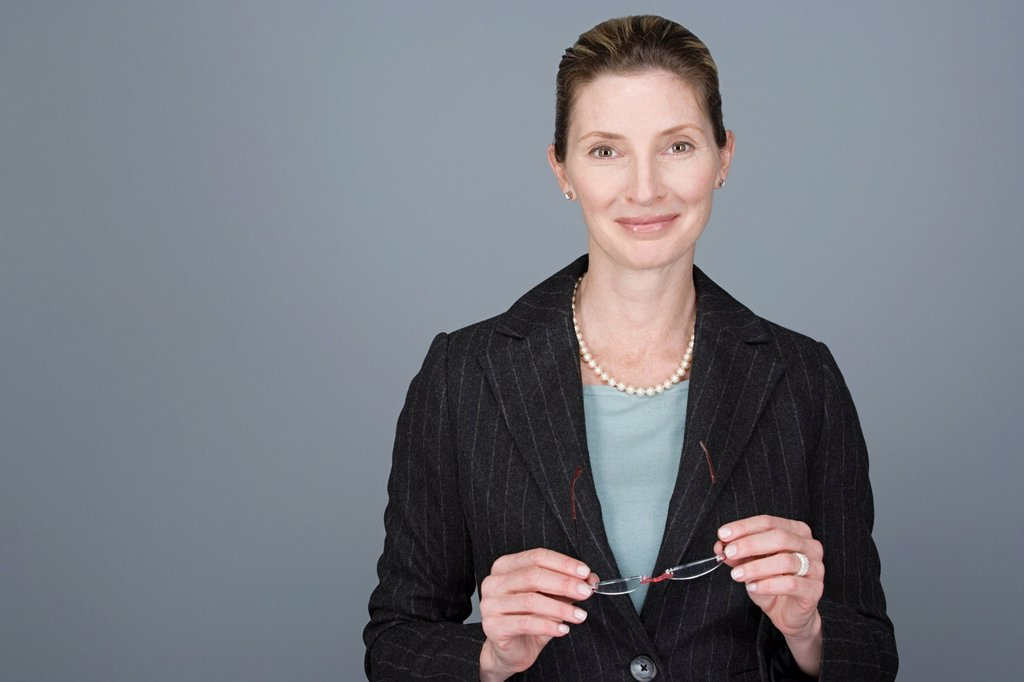 Stock Photo: 1795R-61388 Portrait of cheerful mature businesswoman