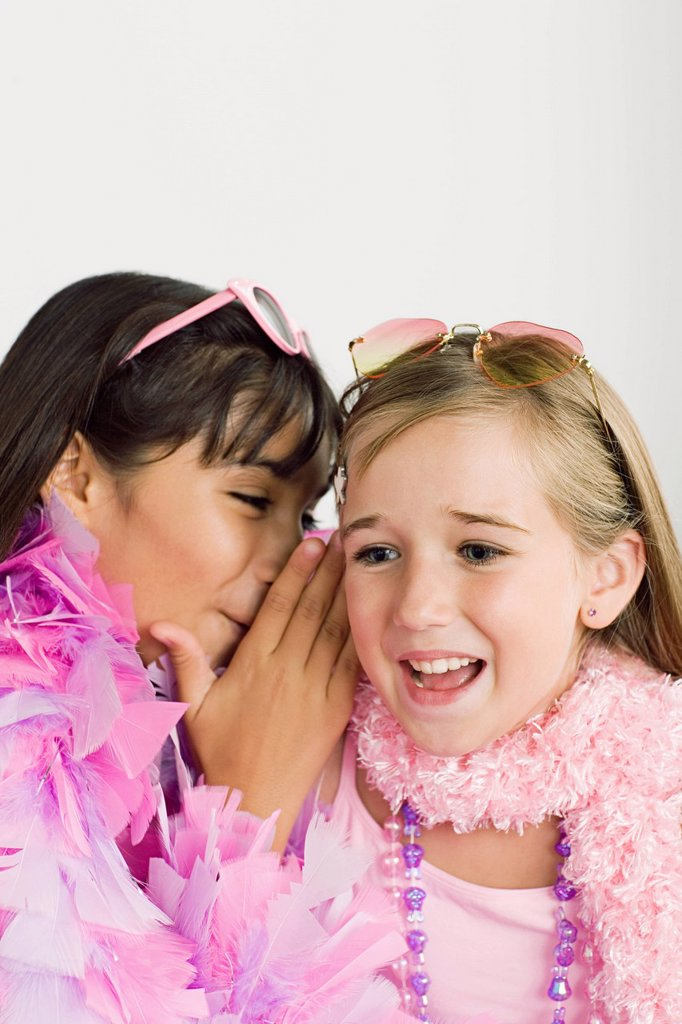 Stock Photo: 1795R-61666 Two girls (10-11) gossiping