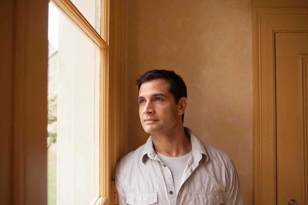 Stock Photo: 1795R-61705 Portrait of man looking out window