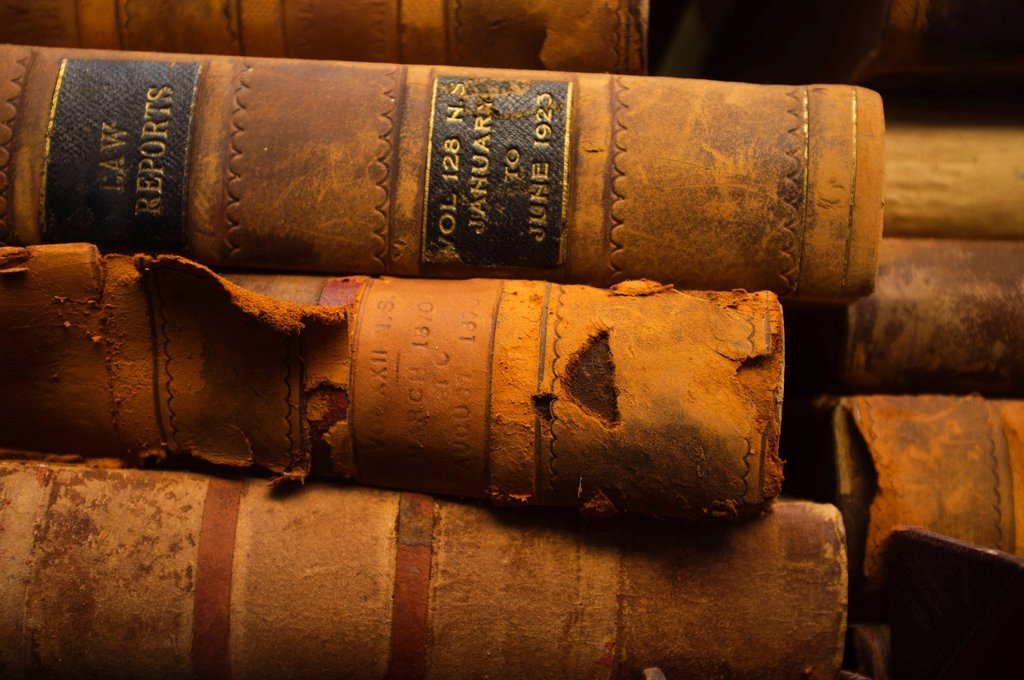 Close up of antique books in leather covers, studio shot : Stock Photo