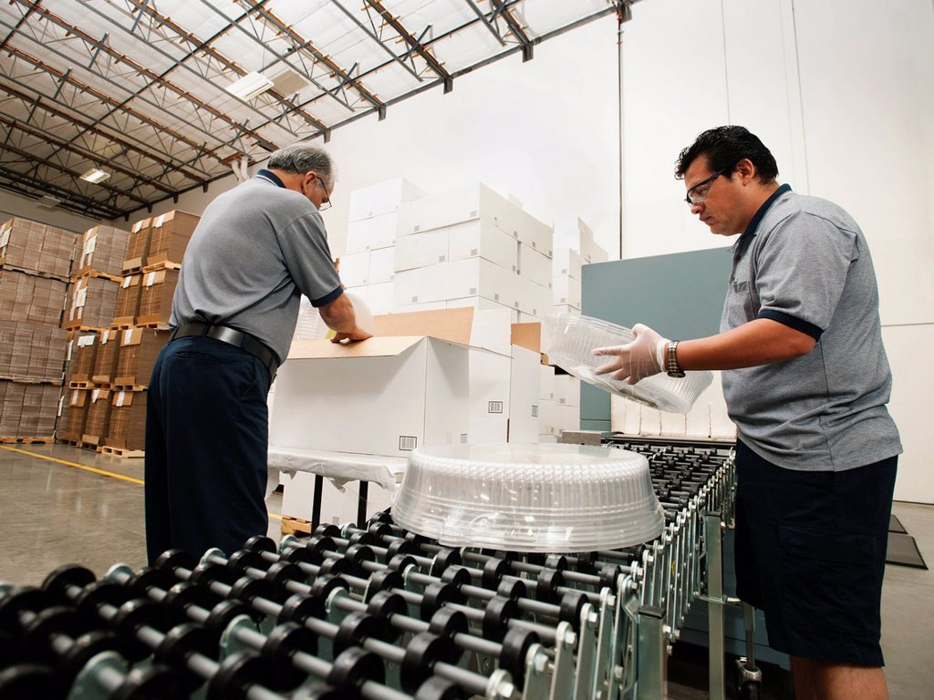 Stock Photo: 1795R-63567 Warehouse workers assembling merchandise