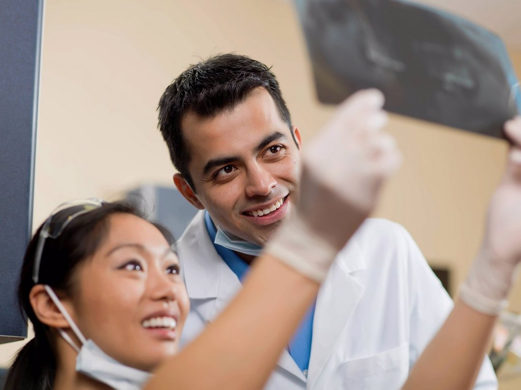 Dentists checking x-ray image : Stock Photo