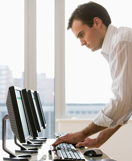 Stock Photo: 1795R-6411 Businessman typing on computer