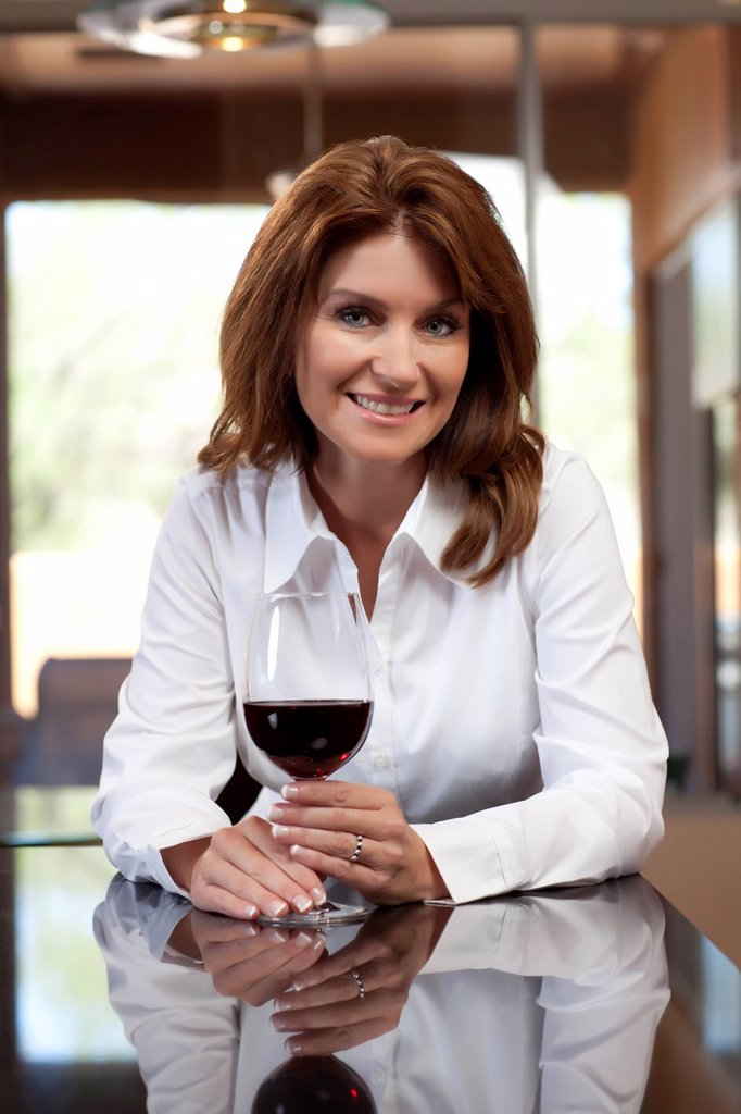 Portrait of woman with glass of wine : Stock Photo