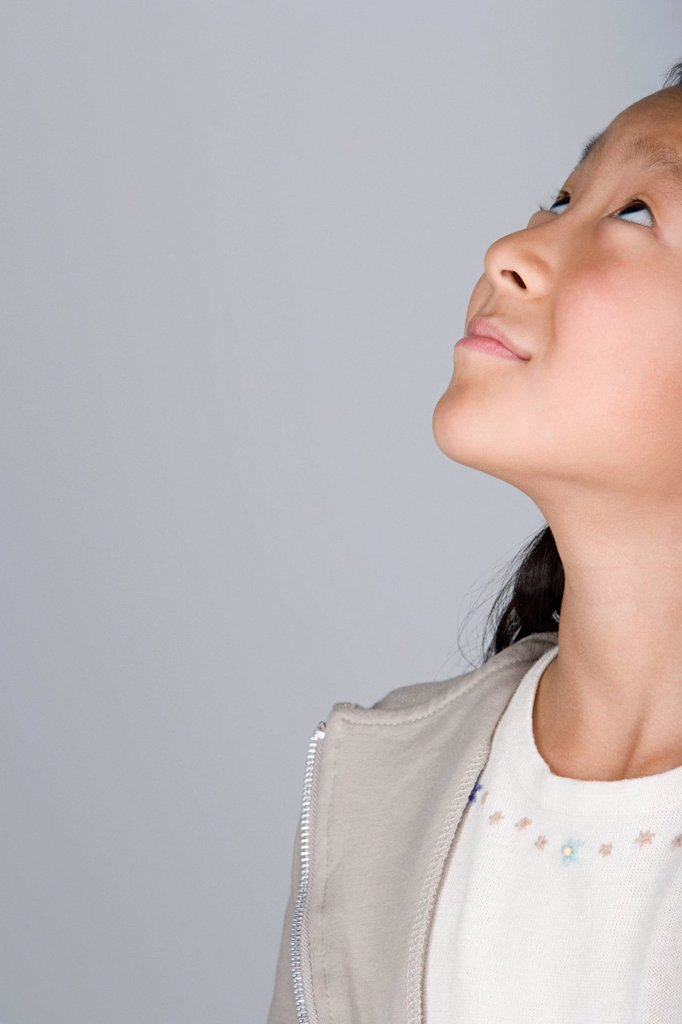 Stock Photo: 1795R-64810 Studio shot of teenage girl looking up, part of