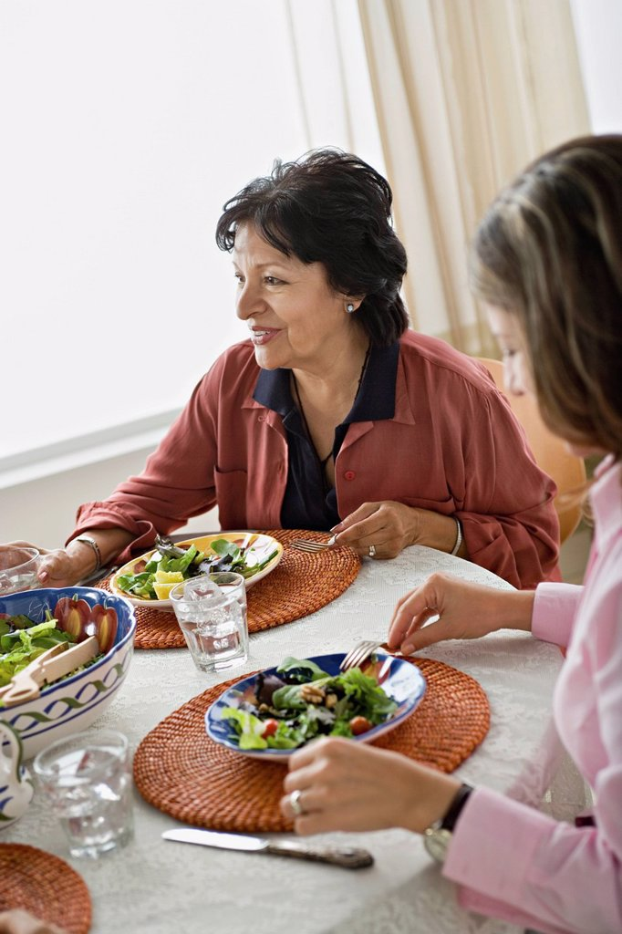 Family having meal together : Stock Photo
