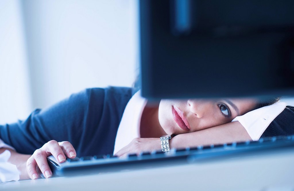 Stock Photo: 1795R-65346 Businesswoman looking tired in front of computer