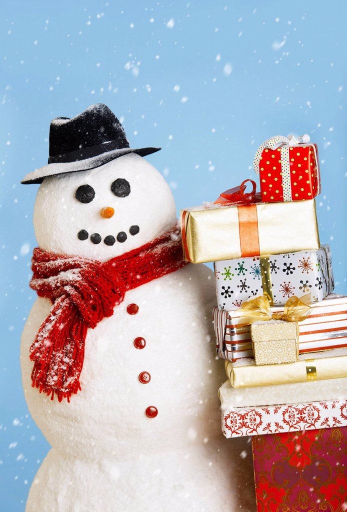 Stock Photo: 1795R-65386 Studio shot of snowman with Christmas presents