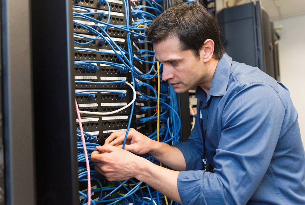 Stock Photo: 1795R-65438 Technician inspecting network server