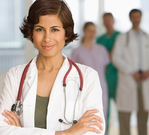 Female doctor with arms crossed : Stock Photo