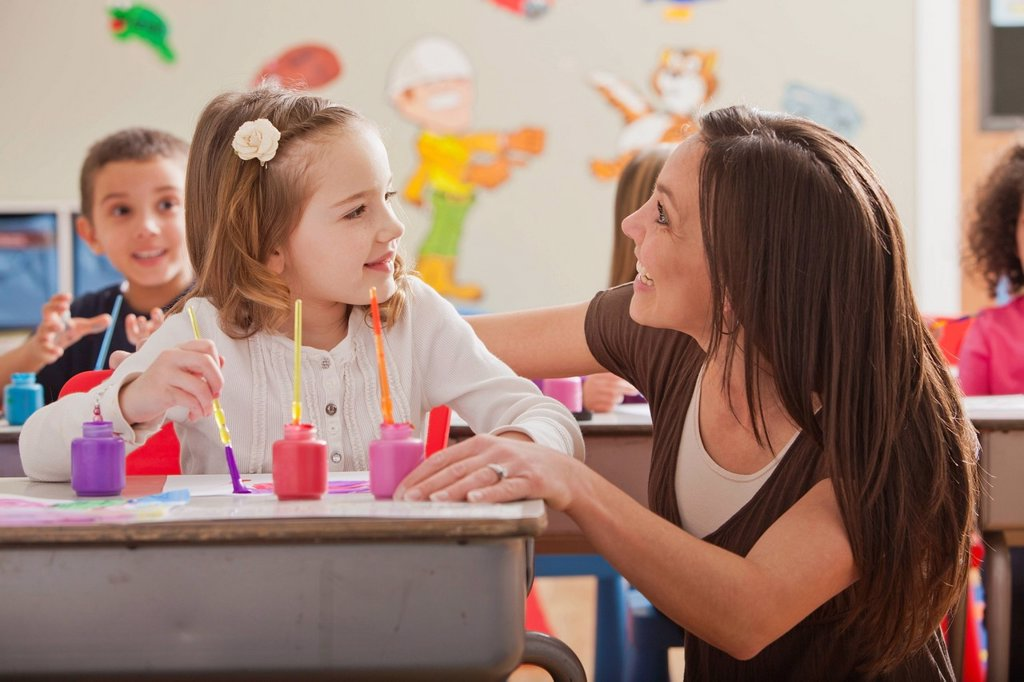Stock Photo: 1795R-66663 Teacher with children 2_3, 4_5, 6_7 during art classes