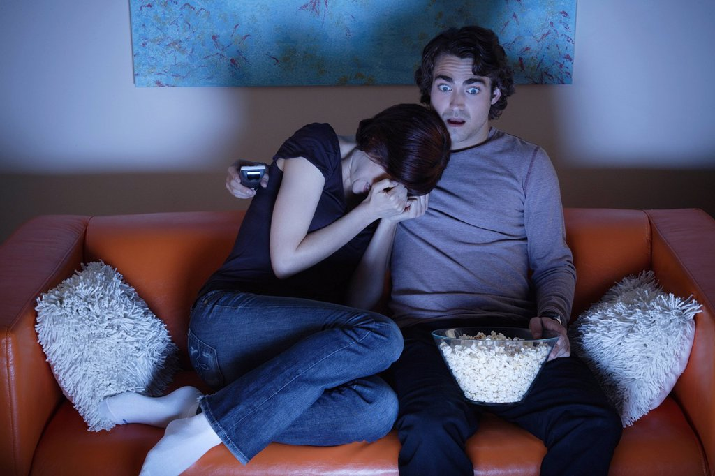 Stock Photo: 1795R-66807 Young couple watching TV