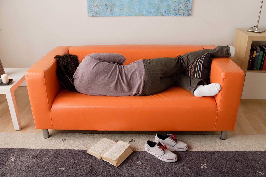 Man sleeping on sofa : Stock Photo