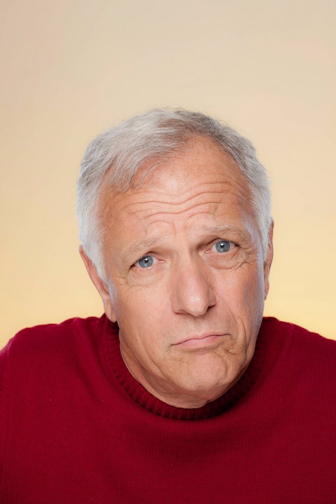Stock Photo: 1795R-67289 Studio shot of confused senior man