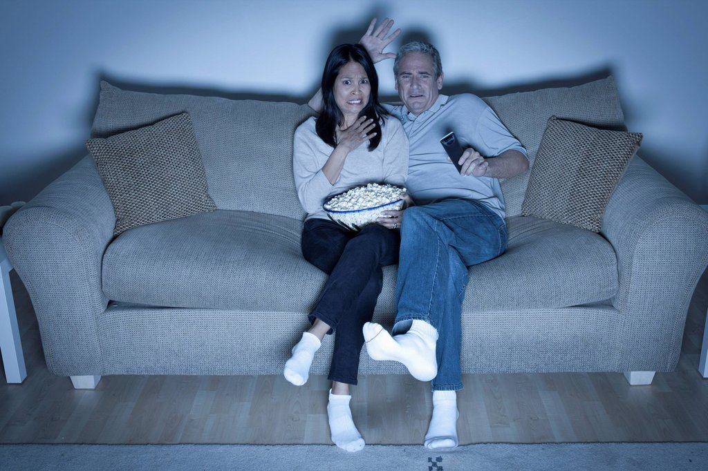 Stock Photo: 1795R-67426 Couple watching television