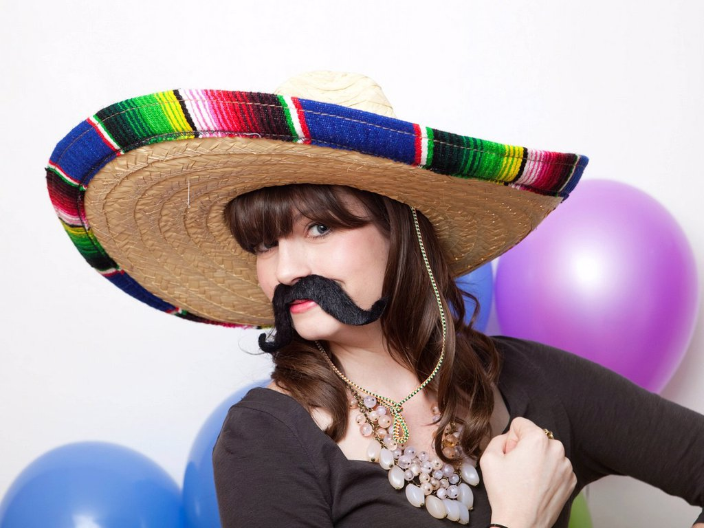 Studio Shot of young woman dressed up as Mexican : Stock Photo