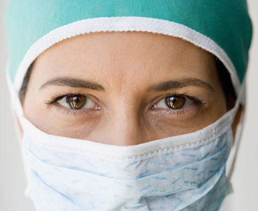 Close up of female doctor wearing surgical mask : Stock Photo